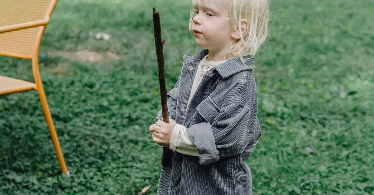 A young boy holding a baseball bat on a field